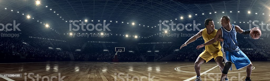 Panoramic basketball game moment stock photo