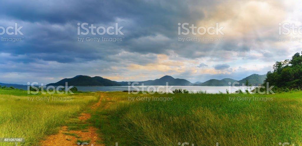 Panoramic beautiful scenery of Srinagarind Reservoir or Srinakharin dam with sunray in the evening , Kanchanaburi Province , Thailand stock photo