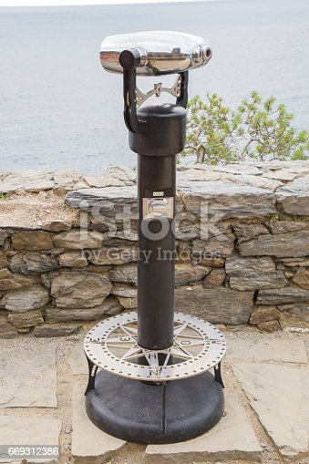 Panoramic binoculars on the stone tower.In the Five Terre.In Liguria region.The Cinque Terre is a rugged portion of the Ligurian Riviera di Levante on the territory of the province of La Spezia between Punta Mesco and Punta di Montenero.