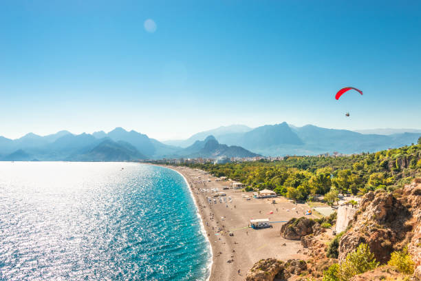 Panoramic bird view of Antalya and Mediterranean seacoast and beach with a paraglider, Antalya, Turkey Panoramic bird view of Antalya and Mediterranean seacoast and beach with a paraglider, Antalya, Turkey, Autumn turkish stock pictures, royalty-free photos & images