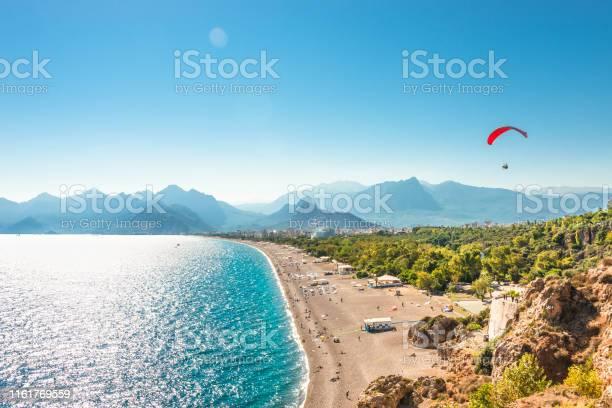 Photo of Panoramic bird view of Antalya and Mediterranean seacoast and beach with a paraglider, Antalya, Turkey