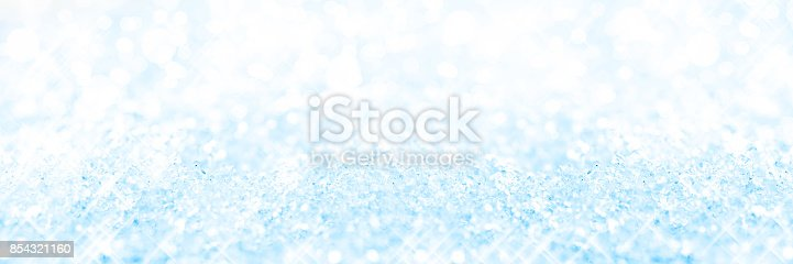 istock Panoramic blue background of snow, holiday glittering background 854321160