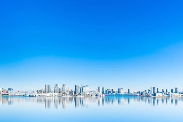 panoramic city skyline of tokyo bay in odaiba, Japan Asia Business concept for real estate and corporate construction - panoramic city skyline aerial view of tokyo bay with mirror reflection under blue sky in odaiba, Tokyo, Japan tokyo stock pictures, royalty-free photos & images