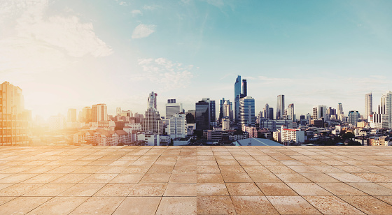693903950 istock photo Panoramic city view in sunrise with empty wooden floor 691394812