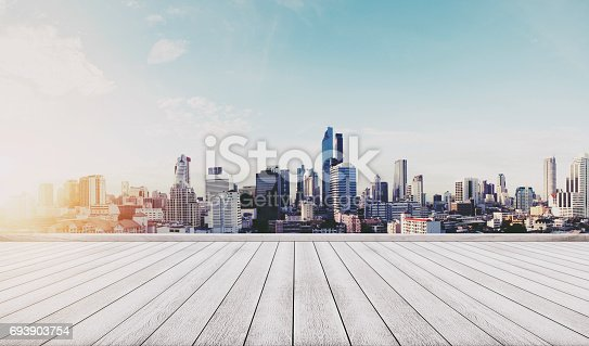693903950istockphoto Panoramic city view in sunrise with wooden floor 693903754