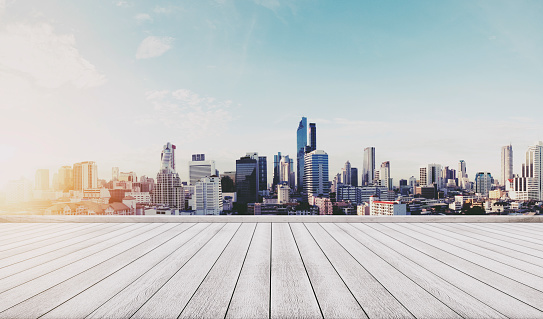 693903950 istock photo Panoramic city view in sunrise with wooden floor 693903754