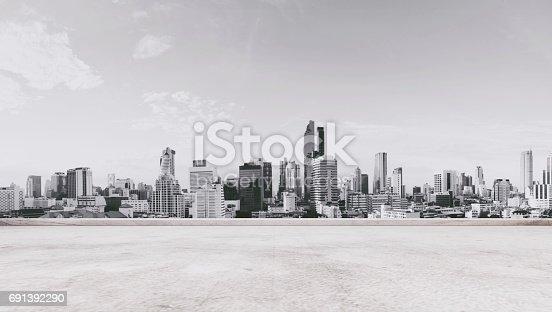 693903950istockphoto Panoramic city view with empty concrete floor 691392290