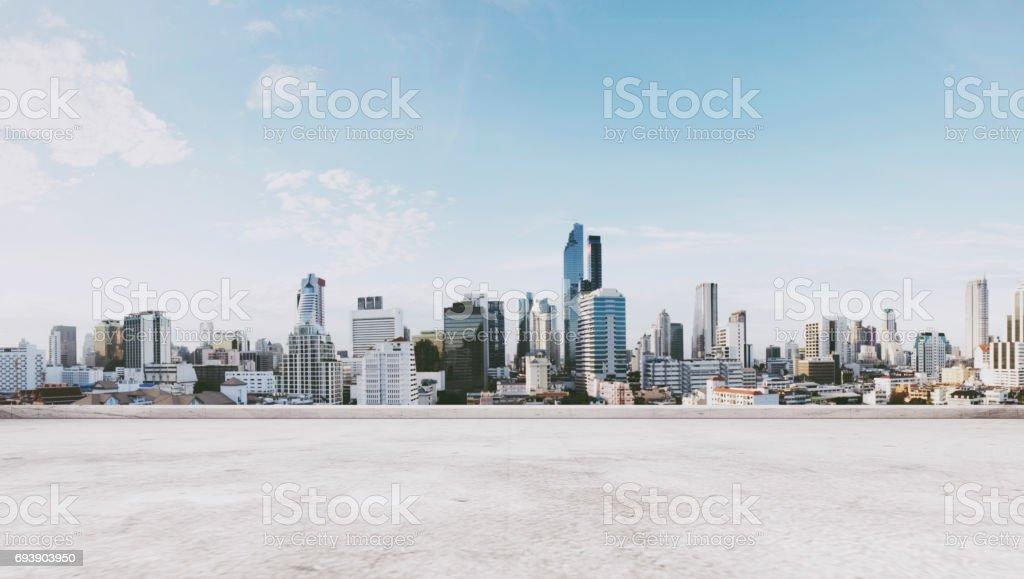 Panoramic city view with empty concrete floor stock photo