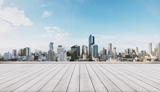 693903950 istock photo Panoramic city view with empty white wooden floor 691394794