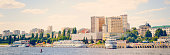 Panoramic cityscape and ships, view from the river side. Toning in the style of instagram.