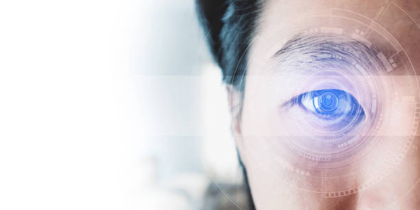 Panoramic close-up Asian businessman's eye , with futuristic technology visual effect stock photo