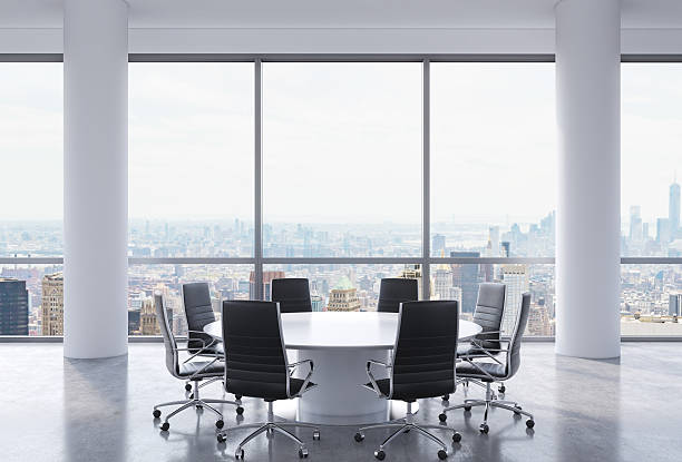 Panoramic conference room in modern office Panoramic conference room in modern office, New York city view. Black chairs and a white round table. 3D rendering. governing board stock pictures, royalty-free photos & images