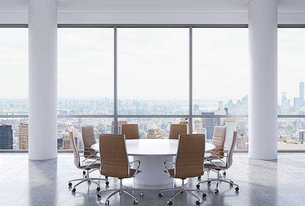 Panoramic conference room in modern office, Panoramic conference room in modern office, New York city view. Brown chairs and a white round table. 3D rendering. governing board stock pictures, royalty-free photos & images