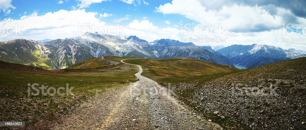 Panoramic Country Road over the Alps stock photo