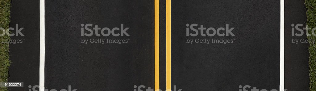 Large cross-section panoramic view of a newly paved asphalt road...
