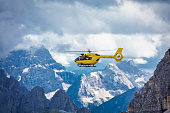 Panoramic flight over the mountains. Air transport. Helicopter flight over the epic landscape. Rescue mission in the wilderness.