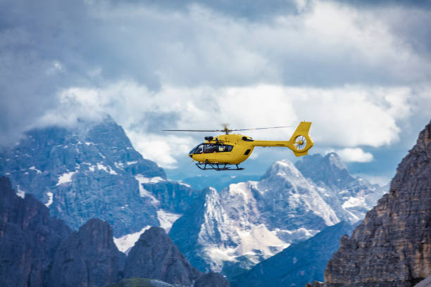 Panoramic flight over the mountains. Air transport. Panoramic flight over the mountains. Air transport. Helicopter flight over the epic landscape. Rescue mission in the wilderness. rescue stock pictures, royalty-free photos & images