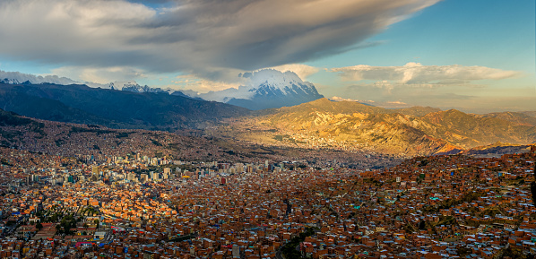 istock Panoramic HDR photo of the city of La Paz, Bolivia, during sunset with Illimani Mountain rising in the background 1226263075