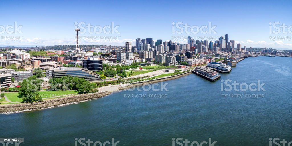 Panoramic Helicopter View of Seattle, Washington Waterfront on Sunny Summer Day with Skyline of Buildings stock photo