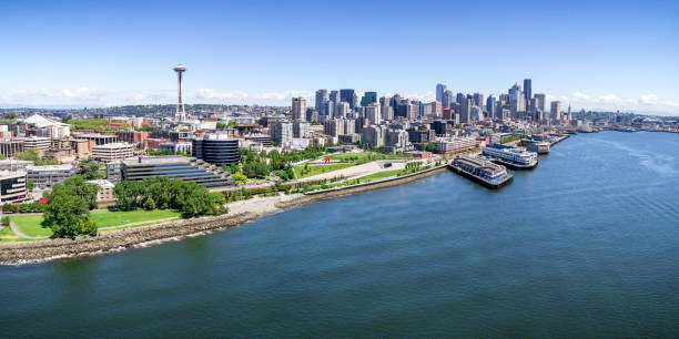 panoramic helicopter view of seattle, washington waterfront on sunny summer day with skyline of buildings - seattle стоковые фото и изображения