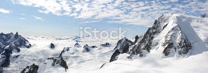 istock Panoramic high mountains climb landscape 493657822