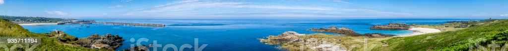 Panoramic image from Braye Beach on the left to Corblets Beach, Fort Corblets and Quesnard Lighthouse, Alderney, Guernsey, Channel Islands stock photo