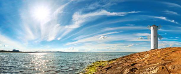 panorama-bild von einem meer von lighthouse in swinoujscie, polen - usedom stock-fotos und bilder