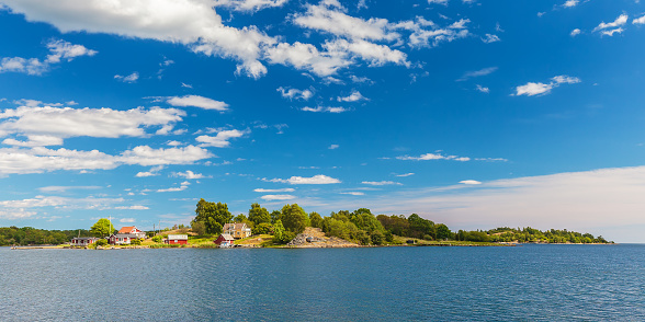 Panoramic image of a small swedish island with old wooden houses in the province of Blekinge