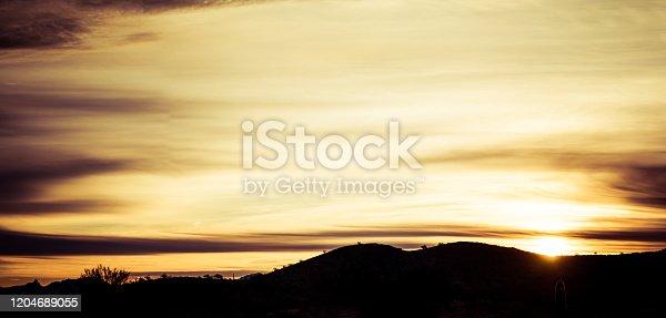 Panoramic image of a sunset over the Sonoran Desert of Arizona.