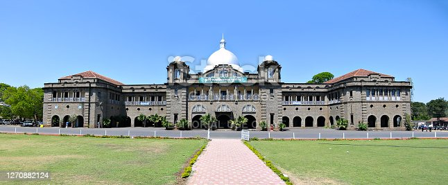 Pune, Maharashtra, India - March 12, 2005 : Panoramic image of ancient Agriculture college building. It is constructed of shaped stones.