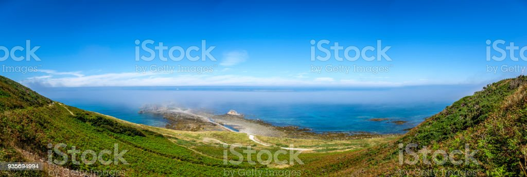 Panoramic image of Fort Clonque in the morning fog, Alderney, Guernsey, Channel Islands stock photo