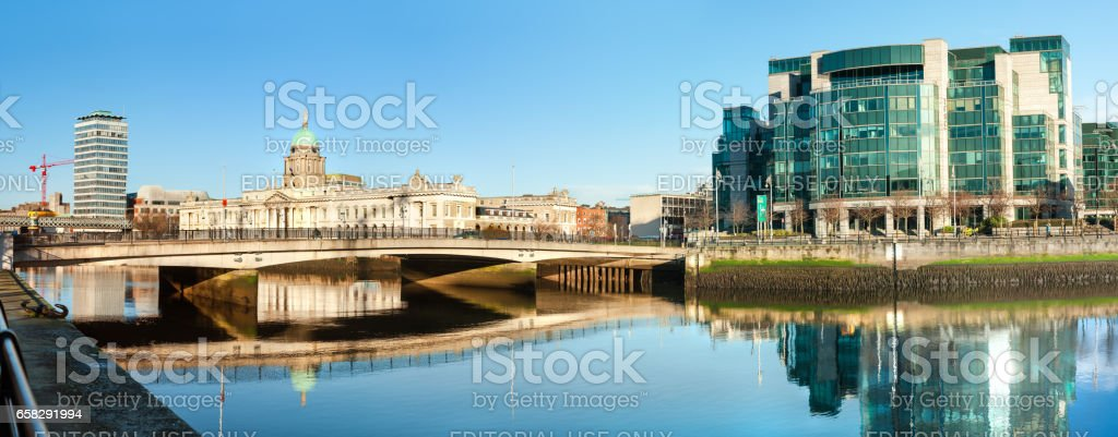 Panoramic image of river Liffey in Dublun with two Customs houses, old and new stock photo
