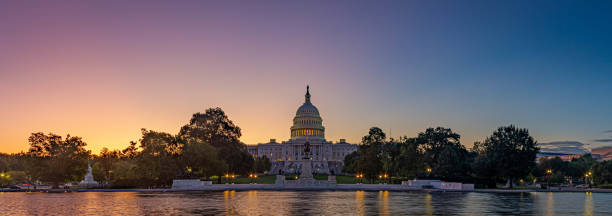 Panoramic image of the Capitol of the United States with the capitol reflecting pool stock photo