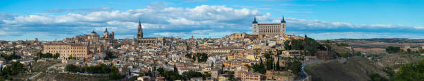 Panoramic image of Toledo city - spain Panoramic image of Toledo old city santa cruz seville stock pictures, royalty-free photos & images