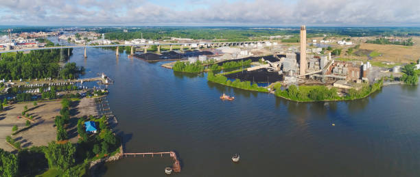 panoramic industrial landscape on fox river in green bay, wisconsin. - green bay wisconsin stock photos and pictures
