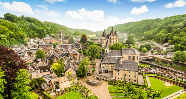 Panoramic landscape of Durbuy, Belgium. Smallest city in the world. Aerial view of city centre of Durbuy. Buildings and green nature. Blue sky with white clouds. Panoramic view. Bright and colorful image. belgium stock pictures, royalty-free photos & images