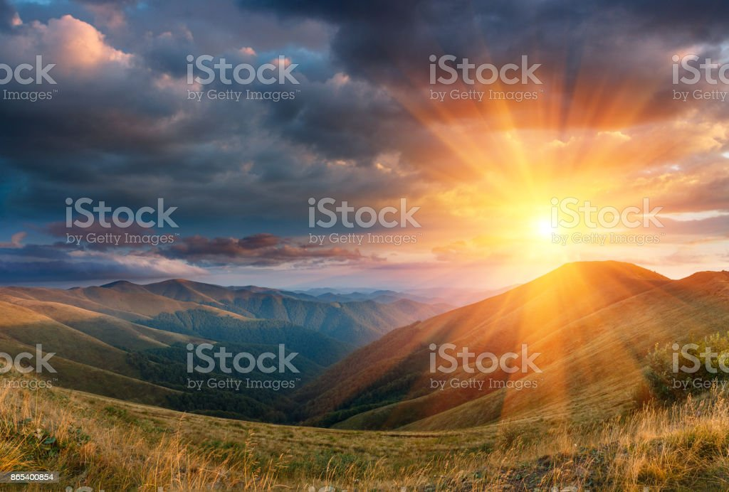 Panoramic landscape of fantastic sunset in the autumn mountains. stock photo