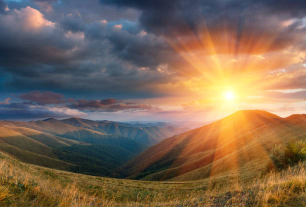 panoramic landscape of fantastic sunset in the autumn mountains. - mountain range stock pictures, royalty-free photos & images
