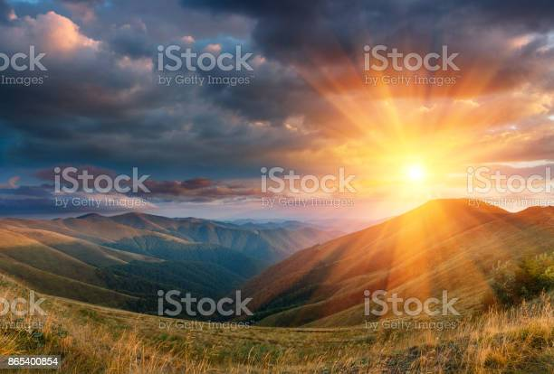 Photo of Panoramic landscape of fantastic sunset in the autumn mountains.
