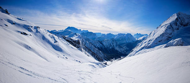 panoramic landscape of snowy dolomites - mountain range stock photos and pictures