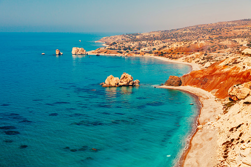 istock Panoramic landscape Petra tou Romiou (The rock of the Greek), Aphrodite's legendary birthplace in Paphos, Cyprus island, Mediterranean Sea. Amazing blue green sea and sunny day. 682675824