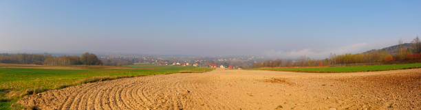 Panoramic landscape with plowed field stock photo