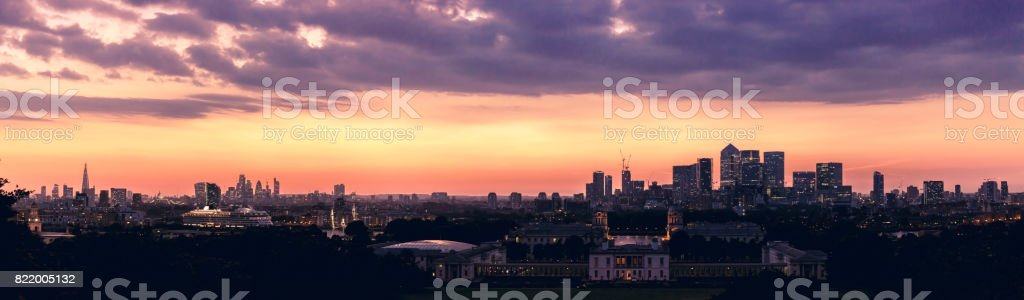 Panoramic London skyline with the Shard London Bridge and Canary Wharf at dusk stock photo