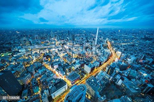 931105838 istock photo panoramic modern city skyline aerial night view of Ikebukuro and expressway in tokyo, Japan 931106836