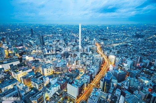 931105838 istock photo panoramic modern city skyline aerial night view of Ikebukuro and expressway in tokyo, Japan 931106914