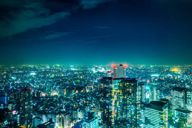 panoramic modern city skyline aerial night view of shinjuku area under twilight sky in tokyo, japan - shinjuku ward stock photos and pictures