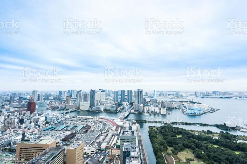panoramic modern city skyline bird eye aerial view of Odaiba bay and bridge under dramatic sunrise and morning blue cloudy sky in Tokyo, Japan stock photo
