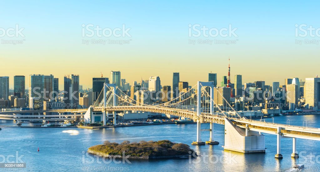 panoramic modern city skyline bird eye aerial view of Odaiba, tokyo tower & rainbow bridge under golden sun stock photo