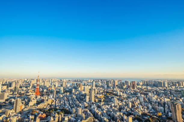 panoramic modern city skyline bird eye aerial view of tokyo tower and odaiba under golden sun stock photo
