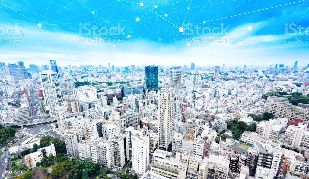 panoramic modern city skyline bird eye aerial view under dramatic glow and beautiful dark blue sky stock photo